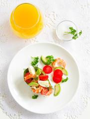 Avocado salad with shrimp and quail eggs.