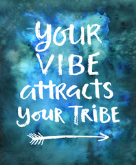 Your vibe attracts your tribe. Hand drawn modern calligraphy on a watercolor background