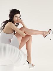 Underwear model on a chair