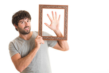 Portrait of a man holding picture frame.