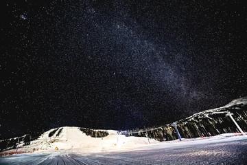 starry sky over the ski slopes