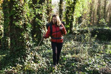 Spain, Catalunya, Girona, female hiker walking in the woods
