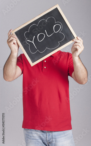 Motivational concept with man holding a board with You Only