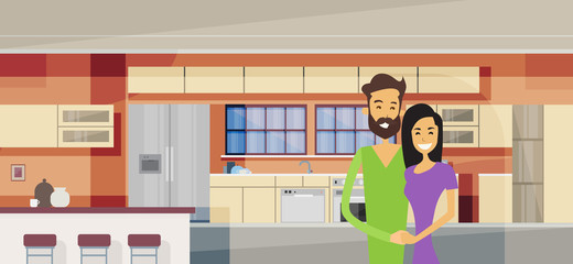 Couple Embracing In Modern Kitchen Interior