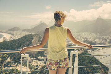 Brazil, Woman looking down onto Rio de Janeiro from Sugarloaf Mountain