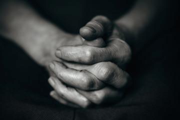 Folded wrinkled old man's hand