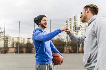 Two basketball players greeting