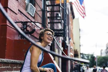 USA, New York City, Williamsburg, portrait of happy blond woman