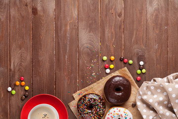 Donuts and coffee on wood
