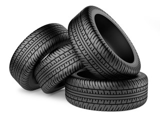 Stack of four new black wheel tyres for car