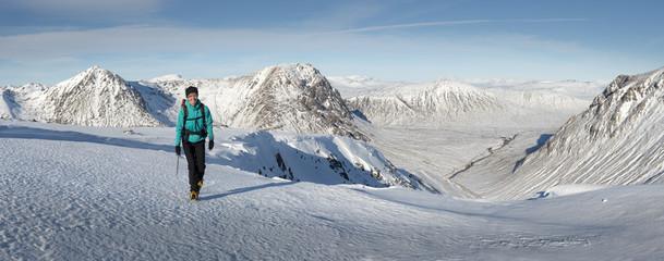 UK, Scotland, Glencoe, Glen Etive, woman walking in winter landscape