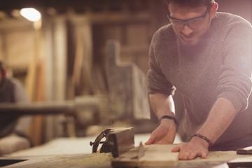 Happy carpenter working on his craft