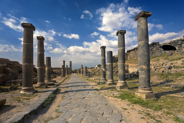 Syria. Bosra. The Cardo street leading along of basalt columns. This site is on UNESCO World Heritage List