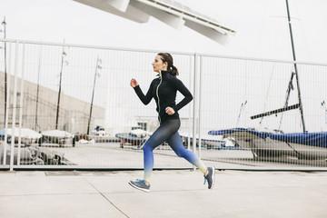 Spain, Barcelona, jogging woman