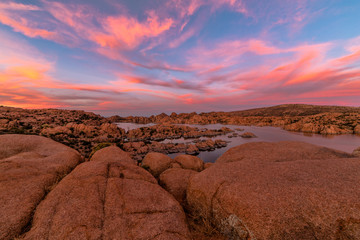 Sunset sky over the rugged rock canyons and mountains surrounding Watson Lake.