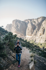 Spain, Catalonia, Parc Natural dels Ports, mother carrying son on her shoulders