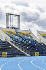 Track and field stadium with empty grandstand