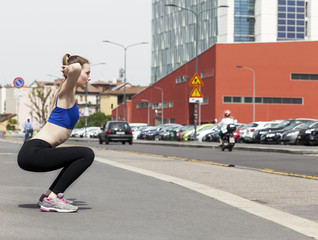 Young woman doing workout in the city