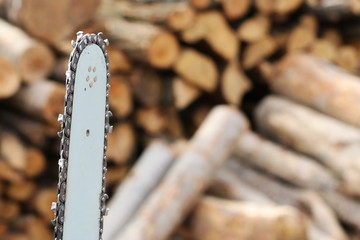 chainsaw and firewood background and texture