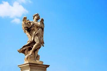 angel statue in Rome against blue sky background