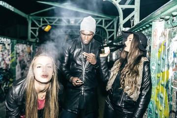 Three friends on a bridge at night