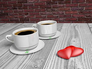 Two cups of coffee and two hearts on a wooden table..