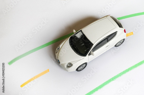 White Toy Car Top View Of A Toy Car On A Road Painted Of Paper