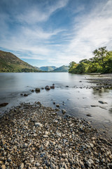 View of Ullswater Lake in the Lake District looking towards Glenridding on a beautiful sunny day.