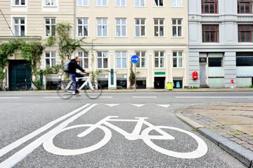Fototapete - Motion blured man on bike