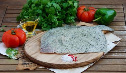 fresh raw flounder, tubot f on the cutting board