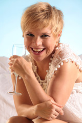 laughing drinking woman