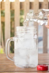 Drinking water is poured into iced glass