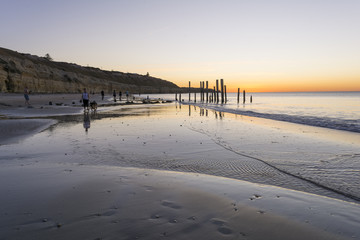 People at Port Willunga Beach, South Australia at sunset