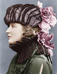 Woman wearing elaborate hat
