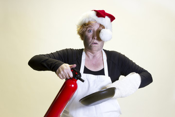 Kitchen disaster, santa hat and fire extinguisher
