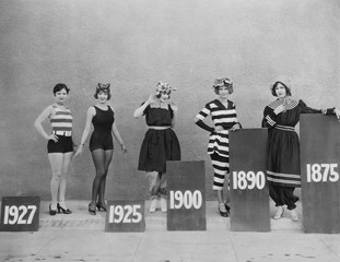 Women wearing fashions of different eras