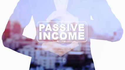 Business woman Holding PASSIVE INCOME message double exposure with blur city.