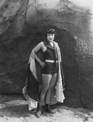 Portrait of woman wearing cape