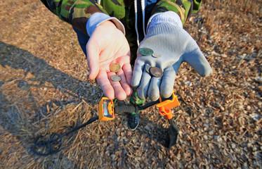 Treasure hunter. Searching with metal detector