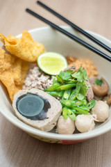 Bowl of noodle with pork ball and special boil egg