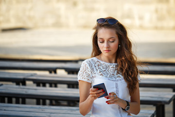 Hipster girl reads sms.