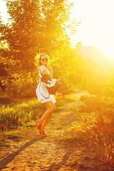 Hippie Girl is walking in park.