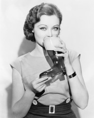 Woman drinking beer out of a boot shaped glass