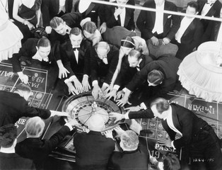 High angle of a group of people playing roulette