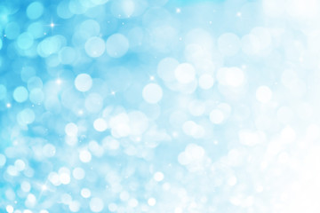 Blue ray bokeh glitter defocused lights abstract background.