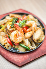 Sizzling seafood with Thai herbs.