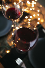 Glass of wine on a table surrounded by lights