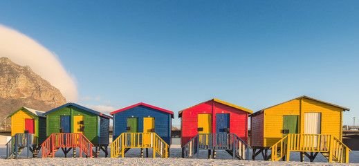 Sunrise at the famous colorful beach huts at Muizenberg Beach outside Cape Town