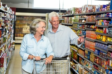 Smiling senior couple buying food