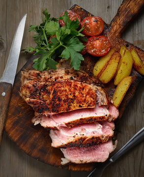 Juicy pork with potatoes, tomatoes and herbs
